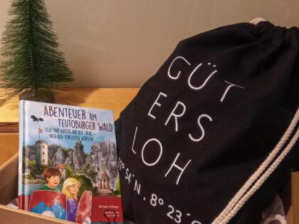 Geschenke-Set aus Turnbeutel mit Gütersloh-Motiv und Buch für Kinder
